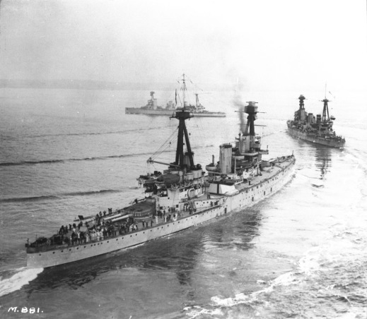 A black-and-white photograph showing three large warships.